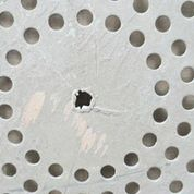 Damaged perforated plate